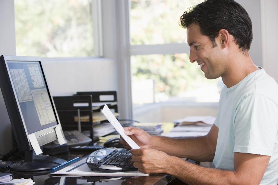 Man doing work on computer in home office