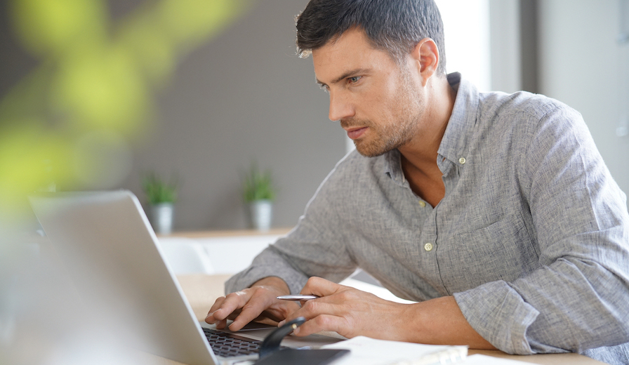 sales man working from home on laptop computer